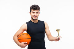 Basketball player holding winners cup Royalty Free Stock Images