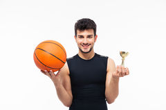 Basketball player holding winners cup. Isolated on white background. Looking at camera stock images