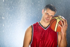Basketball Player Holds His Favorite Ball Royalty Free Stock Photo