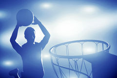 Basketball player jumping and making slam dunk. Basketball player silhouette jumping and making slam dunk. Action lights royalty free stock image