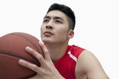 Basketball Player Lining Up His Shot, Studio Shot Stock Photo