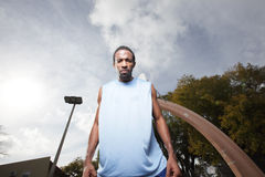 Basketball player looking down at the looser Royalty Free Stock Image