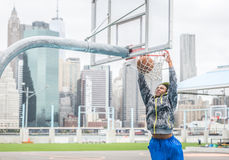 Basketball player making a slam dunk Stock Photos