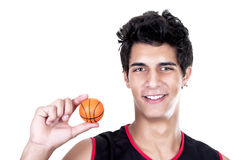 Basketball player with miniature ball Stock Images