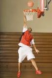 Basketball Player Misses Slam Dunk. Full length of an African American basketball player missing slam dunk stock image