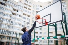 Basketball player in an open stadium hand throws a ball into the ball royalty free stock photos