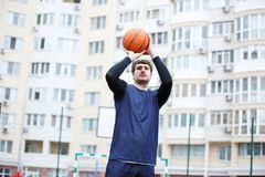 Basketball player in an open stadium with a ball in his hands Royalty Free Stock Image