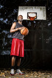Basketball player on the outdoor basketball court. Stock Photo