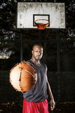 Basketball player on the outdoor basketball court. Royalty Free Stock Photo