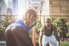 Basketball player playing hard Stock Images