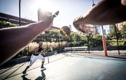 Basketball player playing hard Royalty Free Stock Photo