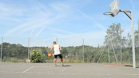 Basketball player practicing stock video footage