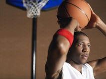 Basketball Player Preparing To Throw Ball Royalty Free Stock Image