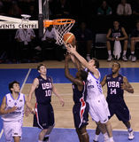 Basketball player rebounding Stock Photo