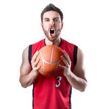 Basketball Player on a red uniform isolated on white background Stock Photography