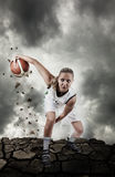 Basketball player running on grungy surface Stock Image