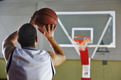 Basketball player shooting Royalty Free Stock Images