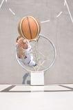 Basketball player shooting Stock Image