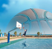 Basketball player shooting by the sea Royalty Free Stock Photo