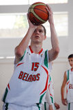 Basketball player shoots a penalty kick. Basketball player pictured in action during the game between Sweeden and Belarus counting for U16 European Championship stock photo