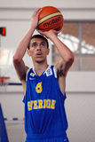 Basketball player shoots a penalty kick. Basketball player pictured in action during the game between Sweeden and Belarus counting for U16 European Championship royalty free stock photos
