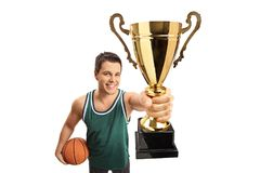 Basketball player showing a gold trophy Royalty Free Stock Photography