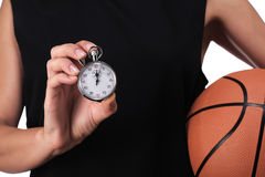Basketball player showing a stopwatch Stock Photography