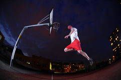 Basketball player slam dunking royalty free stock image