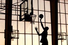 Basketball player slams it Stock Image