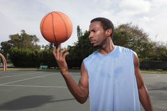 Basketball player spinning the ball Stock Images