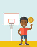 Basketball player spinning ball Stock Images
