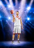 Basketball player is spinning ball around the Royalty Free Stock Photos