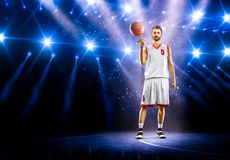 Basketball player is spinning ball around the Royalty Free Stock Images