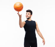 Basketball player spinning ball on his finger. Isolated on a white background Stock Photos