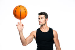Basketball player spinning ball on his finger. Isolated on a white background Royalty Free Stock Image