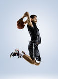 Basketball player is spinning on his finger. Basketball player in action isolated on white Royalty Free Stock Photos