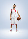 Basketball player is spinning on his finger Royalty Free Stock Photos
