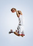 Basketball player is spinning on his finger. Basketball player in action isolated on white Royalty Free Stock Photo