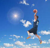 Basketball player in the sun Stock Images