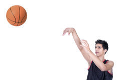 Basketball player throwing the ball Stock Images