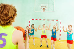 Basketball player throwing ball into the basket Royalty Free Stock Photo