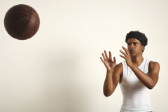 Basketball player throwing a ball stock photos