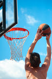 Basketball player throws a ball Stock Images
