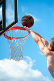 Basketball player throws a ball Royalty Free Stock Image