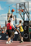 Basketball player throws the ball in the basket Stock Photo