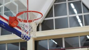 Basketball player throws the ball in the basket stock footage
