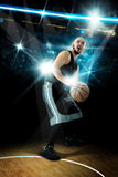 Basketball player throws a ball in the game Royalty Free Stock Photo