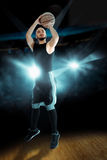 Basketball player throws a ball into the ring in the game Stock Image