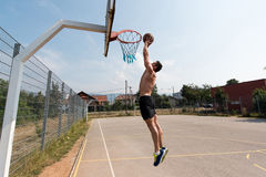 Basketball Player Is About To Slam Dunk Stock Photo