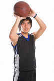 Basketball player is about to throw the ball Stock Images